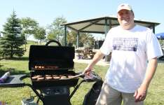 Scott Lautenbaugh cooking burgers ECC Park Event